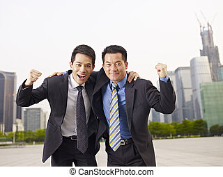 asian business people - asian businessmen celebrating.