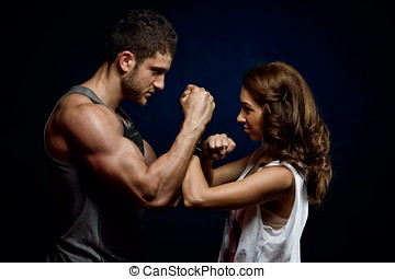 young athletic couple in the gym - young athletic couple in...