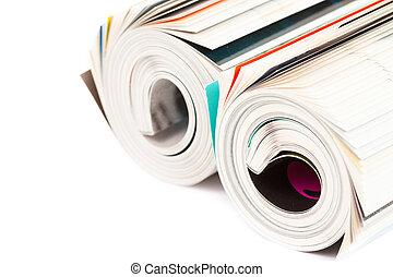 rolled up magazine - on white background