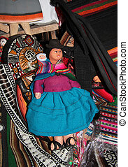 Traditional Bolivian rag doll - cholita with a child in...