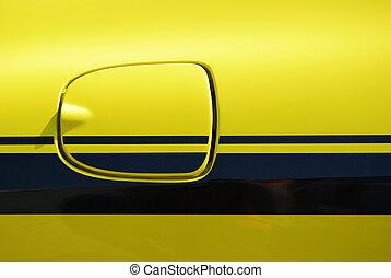 Yellow vehicle fuel filler cap closeup detail