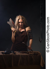 maniac woman with a knife in his hand on a gray background