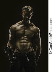 Aesthetic bodybuilding - Handsome athletic young aesthetic...