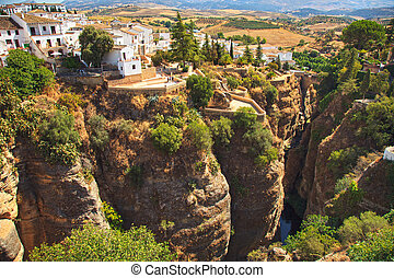 Tajo River gorge in Ronda white village. Andalusia, Spain. -...