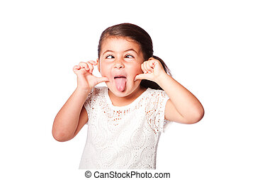 Cross eyed funny face - Cute girl making funny face sticking...