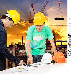 engineer and worker man working in building construction site wi