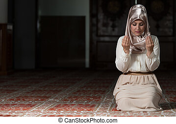 Enlightenment - Young Muslim Woman Praying In Mosque
