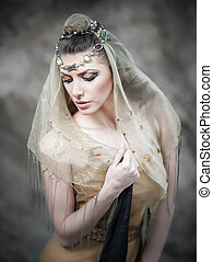 Woman wrapped in veil