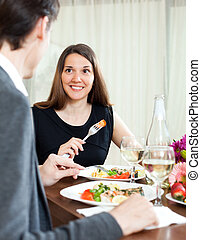 Man and woman having romantic dinner - Handsome man and...