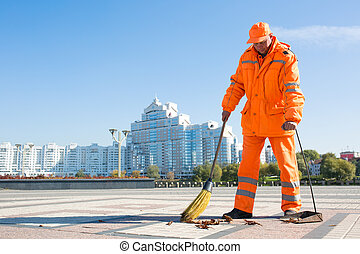 Street sweeper - Man road sweeper caretaker cleaning city...