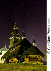 Beautiful wooden church in the village at night