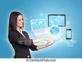 Women using digital tablet and Earth with electronics -...
