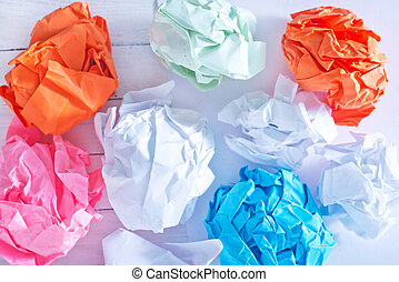 crumpled up paper wads