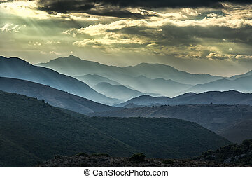 Moody skies over mountains in Balagne region of Corsica -...
