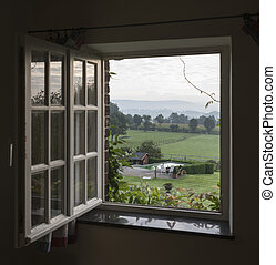 see through window with landscape and hills of belgium as...