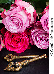 Key with pink roses - Key with fresh oink roses as a symbol...