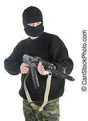 Man in black mask stands with AK-74 machine gun - Man in...