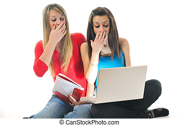shock - scared and shocked two young woman isolated looking...