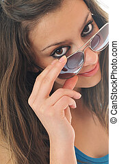 young woman with sunglasses isolated - young woman finger...