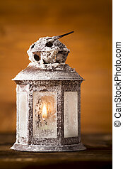 Lantern.  - Christmas lantern on wooden background.