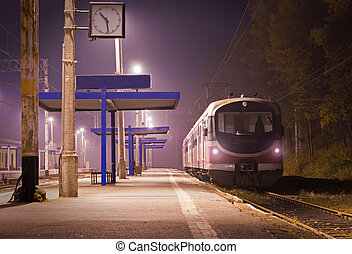 The train station at night. One train.