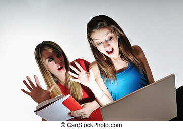 two young woman student work on laptop isolated