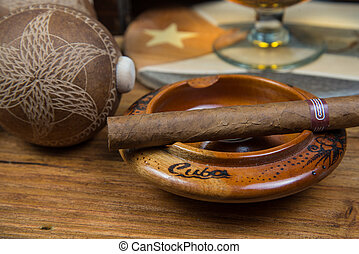 Cigars and Rum or alcohol on table - Cuban cigars and Rum or...