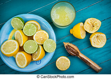 Homemade organic fresh lemon squeezed juice on wooden table...