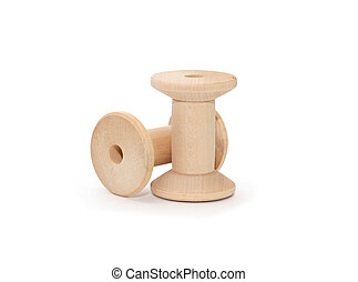 Empty Wooden Spools - Two empty wooden sewing spools on...