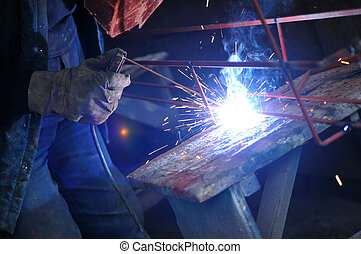 weld machine worker hard industry business