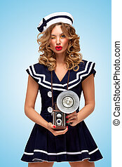Flirty winking - Retro photo of a fashionable pin-up sailor...