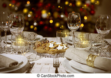 laid table with christmas tree - Festive table with...