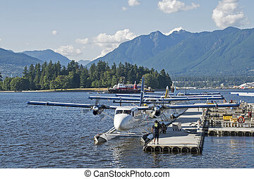 Float planes docked at the pier