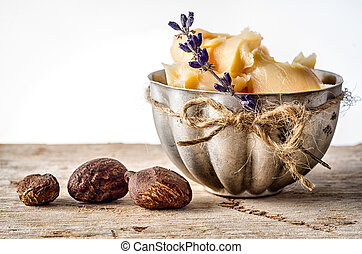 Shea Butter and nuts - Cup of shea butter with shea nuts