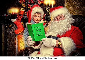 checking the list - Santa Claus and a cute boy reading a...