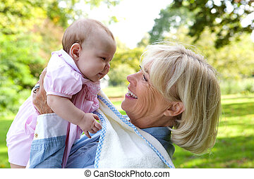Happy grandmother with cute baby - Close up portrait of a...
