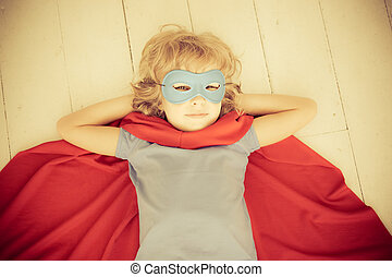 Superhero child at home Retro toned