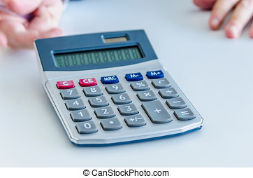 Electronic calculator - An electronic calculator on the desk...