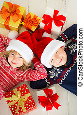 Christmas - Portrait of happy children with Christmas gift...