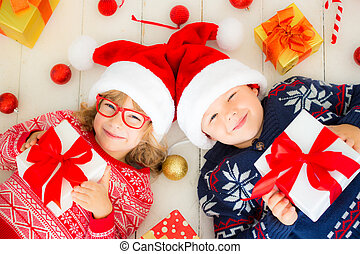 Portrait of happy children with Christmas decorations -...