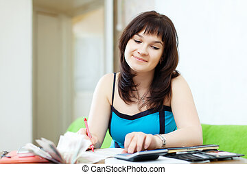 housewife calculates family budget - housewife calculates...