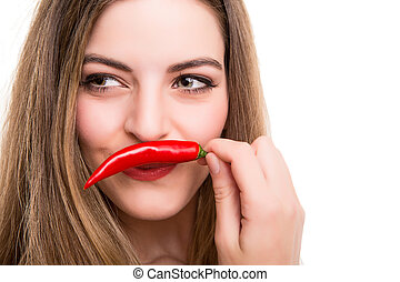 Woman eating pepper