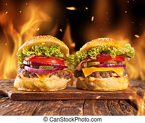Home-made hamburgers with fire - Fresh home-made hamburgers...