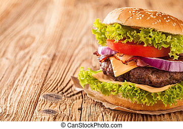 Fresh hamburger on wooden planks - Delicious hamburger on...