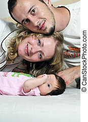 indoor portrait with happy young famil and cute little babby...