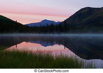 Triple Lakes in Denali National Park during sunrise with fog...