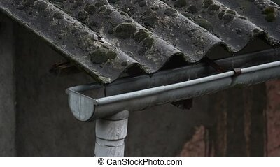 raining over asbestos roof - roof drain pipe detail under...