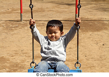 Japanese boy on the swing 2 years old