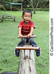 Japanese boy on the seesaw 2 years old