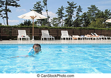 Japanese boy swiming in the pool (1 year old)